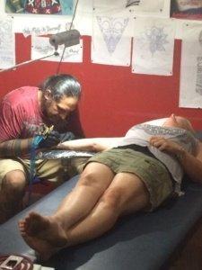 Melissa getting her turtle tattoo The Adventure Travelers